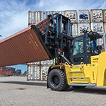 A special container rotator attachment fitted to a heavy-duty Hyster® Lift Truck can lift a dry container or reefer from the 'short' end